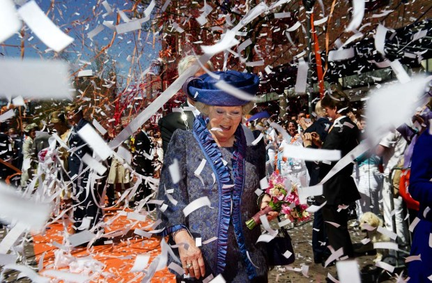 Queen Beatrix of the Netherlands (C) is showered with streamers and confetti during Queen's Day in Veenendaal on April 30, 2012. AFP PHOTO/ANP/ROBIN UTRECHT netherlands out - belgium outROBIN UTRECHT/AFP/GettyImages ORG XMIT: